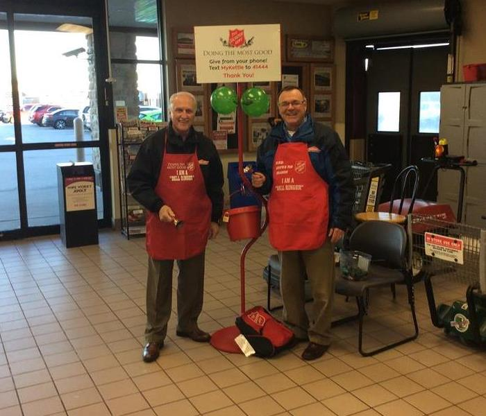 SERVPRO of Brown County Marketing Team stands in front of grocery store entrance to ring bells for the Salvation Army